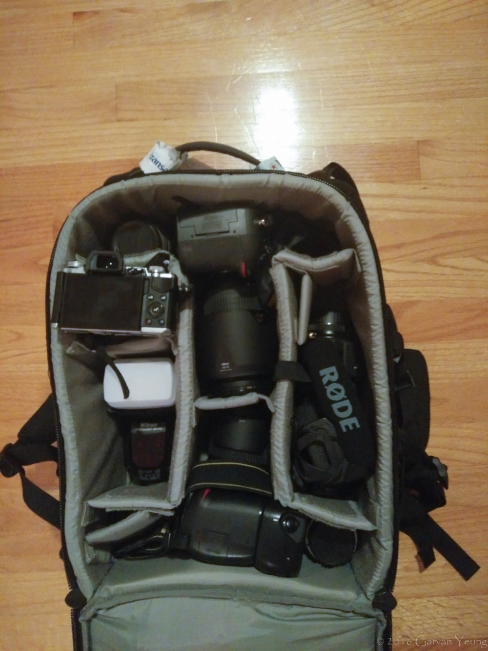 This is the inside of my bag, the Lowepro Vertex 200 AW. I have six lenses, three camera bodies and two flash units.